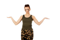 Young soldier woman presenting something on open palm.  stock photography