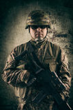 Young soldiers with guns Royalty Free Stock Images