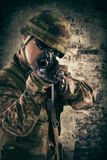 Young soldiers with guns Stock Image