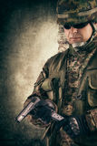 Young soldiers with guns Stock Photography