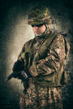 Young soldiers with guns Royalty Free Stock Photos