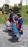 Young soldiers marching with drums during war reenactments, Fort Ontario, New York, 2016 Royalty Free Stock Photo