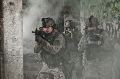 Young soldiers on patrol in smoke Royalty Free Stock Image
