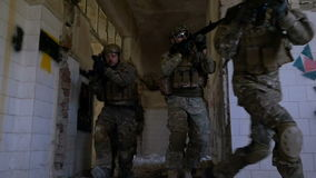 Young soldiers training for counter terrorist operation in a bombarded building stock video