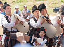 The young soloist of the orchestra of bagpipes in the folklore festival in Bulgaria Stock Images