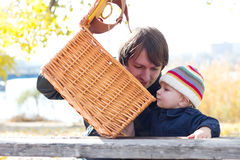 Young son and dad on a picnic with basket Stock Image