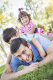 Young Son and Daughter Having Fun With Their Dad Outdoors. Young Son and Baby Daughter Having Fun With Their Dad Outdoors Royalty Free Stock Photos