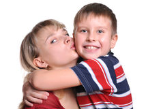 Young son embracing her mother. Young beautiful son embracing her mother stock photography