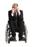 Young sorrowful businessman in a wheelchair. Portrait of a young sorrowful businessman in a wheelchair Royalty Free Stock Image