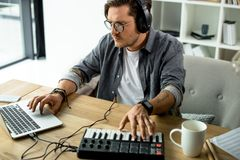 Sound producer. Young sound producer working at modern office Stock Photography