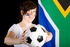 Young south africa supporter holds football ball Royalty Free Stock Photos