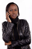 Young South African woman on phone Stock Images