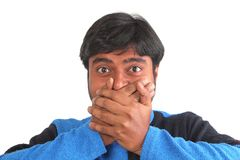 Young south indian closing mouth in disbelief Royalty Free Stock Photos