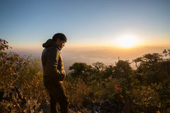Young southeast asian man standing at mountain Stock Photo