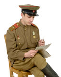 A young Soviet officer isitting read a newpaper Royalty Free Stock Image