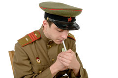 A young Soviet officer smoking a cigarette Stock Images