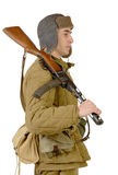 Young Soviet soldier with machine gun ppsh-41. Young Soviet soldier with machine gun on the white background Royalty Free Stock Photos