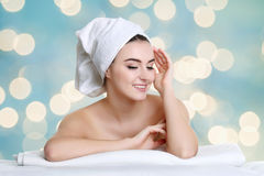 Young spa woman touching her face after beauty treatment. Spa woman touching her face after beauty treatment Royalty Free Stock Photos