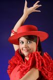 Young and Spanish. Young Spanish flamenco dancer in a red dress Stock Image