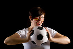 Young spanish female supporter hold ball Royalty Free Stock Images