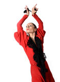 Young Spanish woman dancing flamenco with castanets in her hands. Young Spanish woman dancing Sevillanas with castanets in hands wearing folk red dress in Royalty Free Stock Image