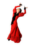 Young Spanish woman dancing flamenco with castanets in her hands Royalty Free Stock Image