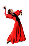 Young Spanish woman dancing flamenco with castanets in her hands. Young Spanish woman dancing Sevillanas with castanets in hands wearing folk red dress in Stock Photography