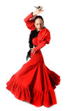 Young Spanish woman dancing flamenco with castanets in her hands. Young Spanish woman dancing Sevillanas with castanets in hands wearing typical folk red dress Stock Photo