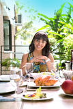Young spanish woman smiling by the dining table Royalty Free Stock Photos