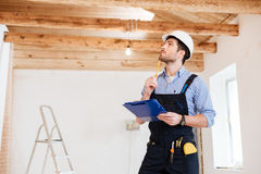 Young specialist builder examines his working space Royalty Free Stock Photos