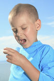 Young sport boy using inhaler outside Royalty Free Stock Photography