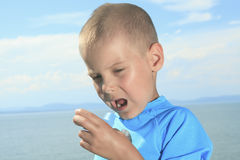 Young sport boy using inhaler outside Stock Photography