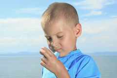 Young sport boy using inhaler outside Royalty Free Stock Image