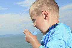 Young sport boy using inhaler outside Stock Image