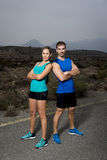 Young sport couple posing shoulder to shoulder looking cool and defiant attitude Stock Photo