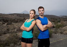 Young sport couple posing shoulder to shoulder looking cool and defiant attitude Stock Photography