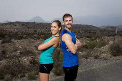 Young sport couple posing shoulder to shoulder looking cool and defiant attitude Royalty Free Stock Images