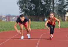 Young sport couple in starting position Royalty Free Stock Photography