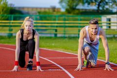 Young sport couple in starting position Royalty Free Stock Photo