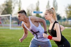 Young sport couple in starting position Stock Photography