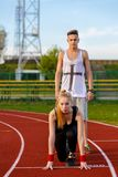 Young sport couple in starting position Royalty Free Stock Images