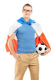 Young sport fan with flag of Holland holding a soccer ball. Isolated on white background Stock Photo