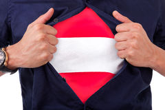 Young sport fan opening his shirt and showing the flag his count Royalty Free Stock Images