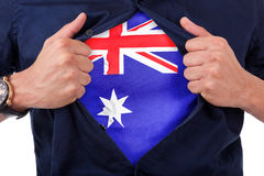 Young sport fan opening his shirt and showing the flag his count. Ry Australia - Australian flag Royalty Free Stock Photos