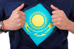 Young sport fan opening his shirt and showing the flag his count. Ry Kazakhstan Stock Image