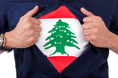 Young sport fan opening his shirt and showing the flag his count. Ry Lebanon, Lebanese flag Stock Photos