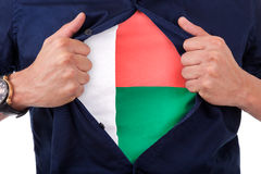 Young sport fan opening his shirt and showing the flag his count. Ry Madagascar,  Malagasy flag Stock Photography