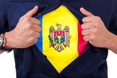 Young sport fan opening his shirt and showing the flag his count. Ry Moldavia, Moldavian flag Stock Image