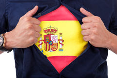 Young sport fan opening his shirt and showing the flag his count. Ry spain, Spanish flag Royalty Free Stock Photography