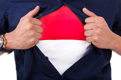Young sport fan opening his shirt and showing the flag of Monaco. Principality , Monacan flag Stock Images